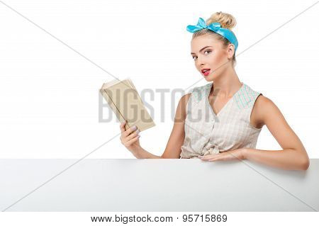 Attractive young woman is reading interesting literature