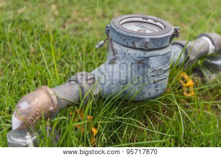Rusty Water Meter On Lawn
