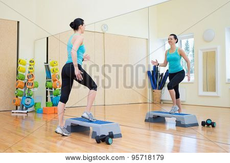 Beautiful Woman Working Out With Stepper In Gym