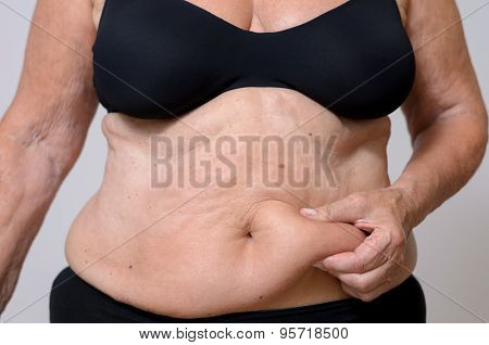 Close Up Middle Aged Woman Holding Her Fatty Belly