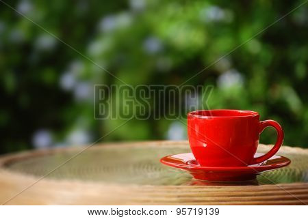 Red Mug Over Green Bokeh