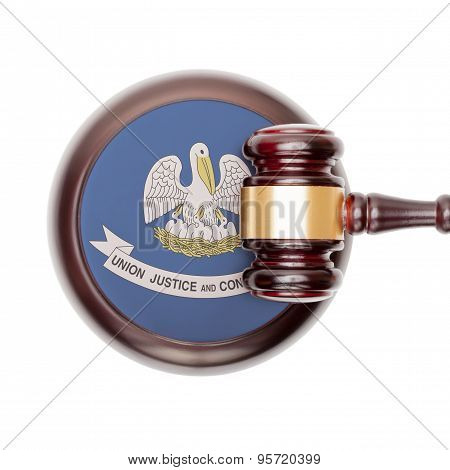 Wooden judge gavel with US state flag on sound block - Louisiana