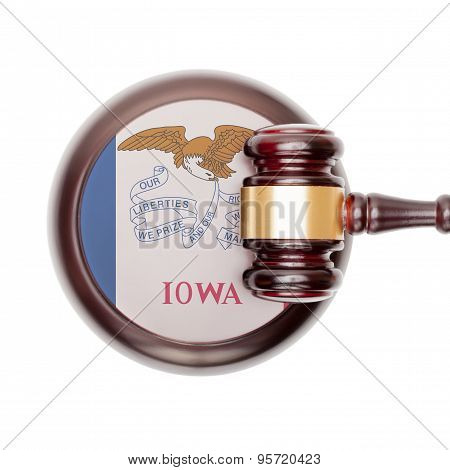 Wooden judge gavel with US state flag on sound block - Iowa
