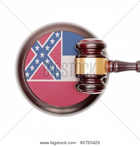 Wooden judge gavel with US state flag on sound block - Mississippi