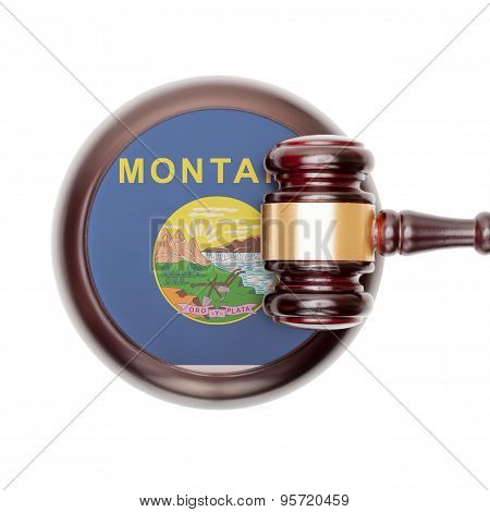 Wooden judge gavel with US state flag on sound block - Montana