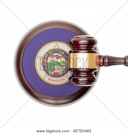 Wooden judge gavel with US state flag on sound block - Minnesota