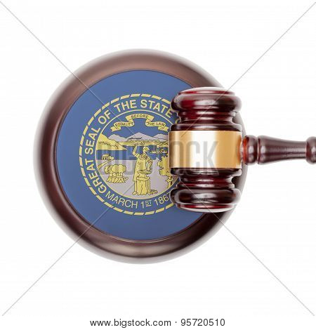 Wooden judge gavel with US state flag on sound block - Nebraska