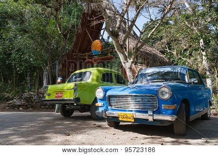 Varadero, Cuba - February 5, 2008. Classic Oldtimer Car Parking Near Trees.