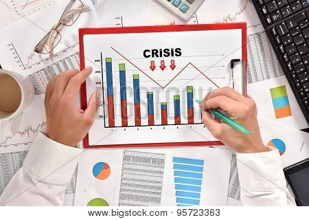 Businessman Drawing Crisis Chart