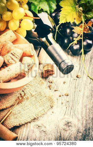 Bottle Of Red Wine With Fresh Grape