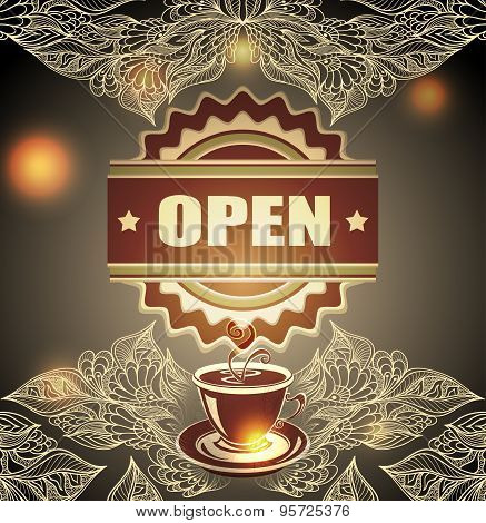 Cup of coffee or tea with badge open and lace on blur background