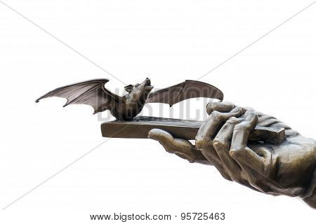 Bat and hand part of brass sculpture isolated on white background