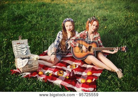 Two Young Happy Girl On Picnic