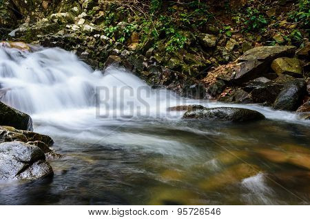 Deep forest waterfall at Pliu waterfall National Park Juntaburi Thailand
