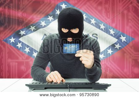 Hacker Holding Credit Card And Usa State Flag On Background - Arkansas