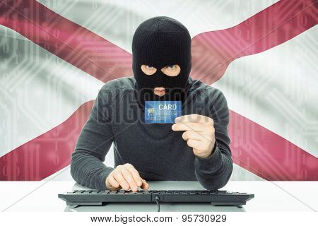Hacker Holding Credit Card And Usa State Flag On Background - Alabama