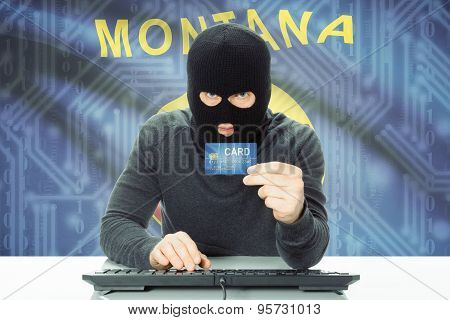 Hacker Holding Credit Card And Usa State Flag On Background - Montana