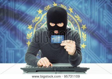 Hacker Holding Credit Card And Usa State Flag On Background - New Hampshire