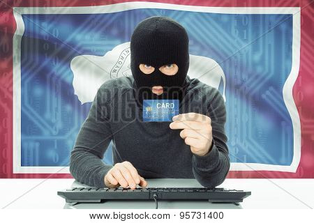 Hacker Holding Credit Card And Usa State Flag On Background - Wyoming