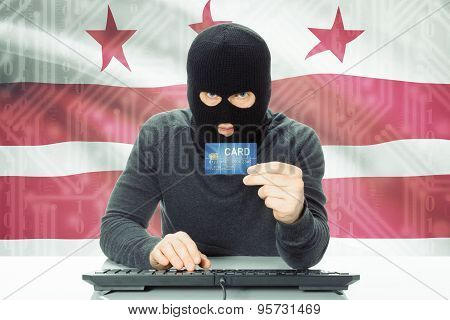 Hacker Holding Credit Card And Usa State Flag On Background - District Of Columbia