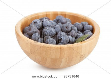 Wooden Bowl With Blueberry Berries On A White Background