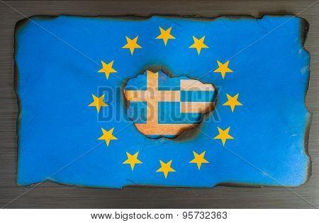 Greek flag behind burnt European flag background