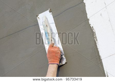 The Process Of Applying Putty To The  Polyfoam Wall