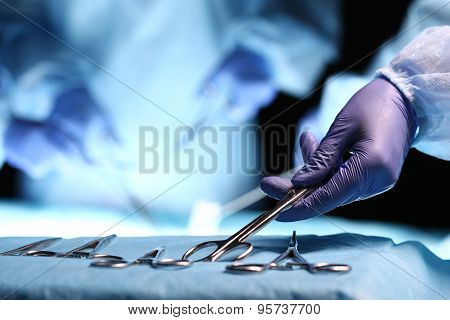 Nurse Hand Taking Surgical Instrument