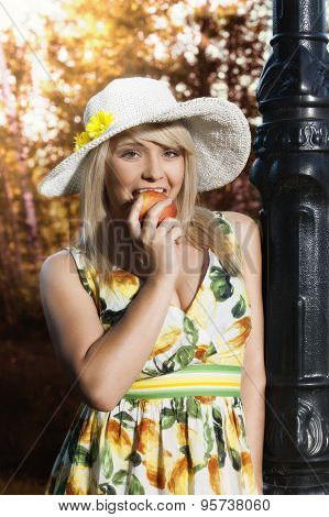 Woman With Apple In The Park