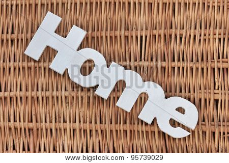 White Wood Sign Home On The Rustic Wicker Background