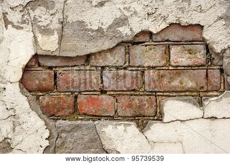 Broken Old Bricklaying From Red White Bricks And Damaged Plaster