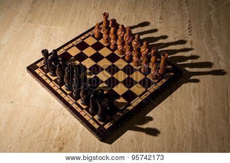 Chess board on travertine floor