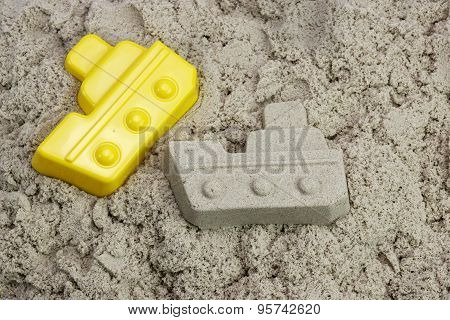 Sand Boat And Plastic Mold On The Beach