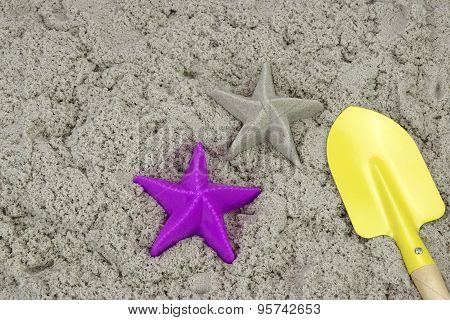 Sand Starfish, Shovel And Plastic Mold On The Beach
