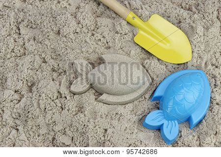Sand Fish, Shovel And Plastic Mold On The Beach