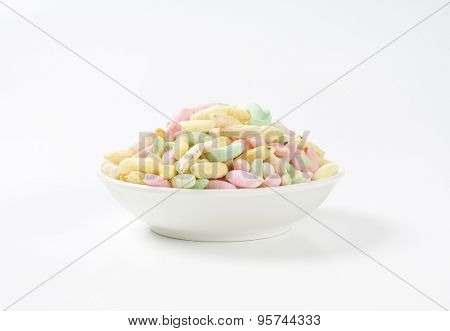 bowl of colorful puffed rice on white background