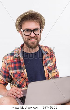 Bearded man with laptop