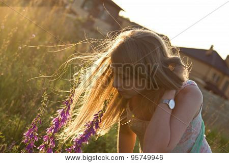 Long Hair In Sunset Light In Windy Weather