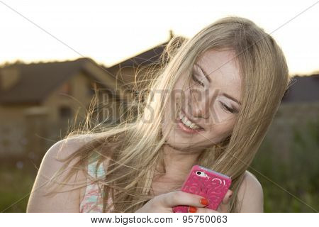 Smiling Blonde In Windy Weather