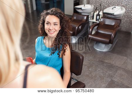 Client sitting in hairdressing salon