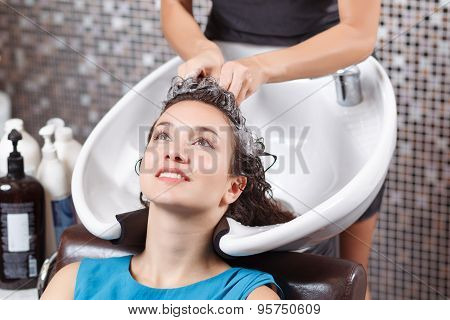 Professional hairdresser washing head
