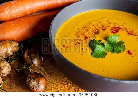 Carrots and chestnuts soup closeup