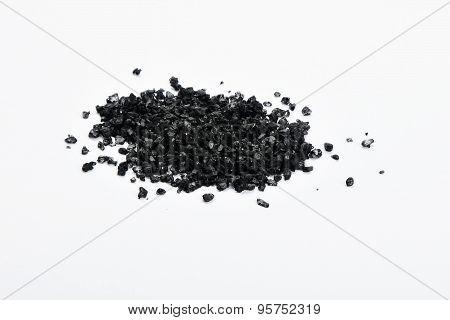 Handful Of Black Hawaiian Sea Salt Isolated On White