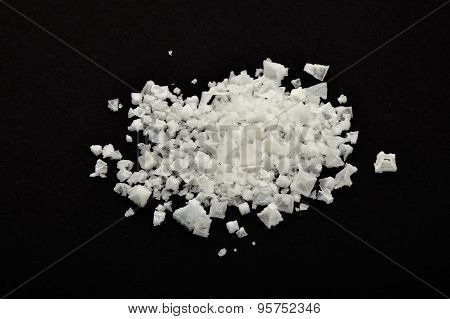 Handful Of White Cyprian Pyramid Sea Salt Isolated On Black