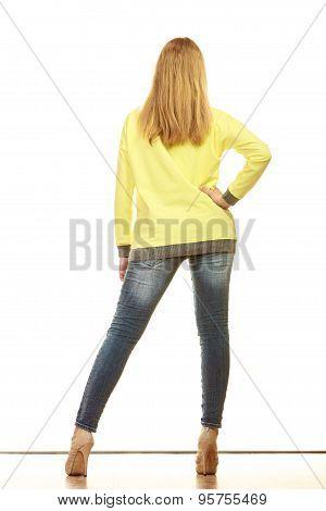 Woman In Denim Pants High Yellow Shirt Back View