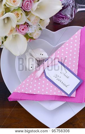 Pink Theme Wedding Table Setting On Dark Wood Background.