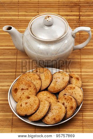 Cookies On A Plate And A Teapot