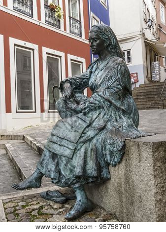 Statue Of Sitting Woman Carrying A Pitcher Of Water