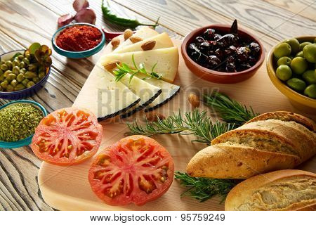 Mediterranean food bread oil olives cheese spices peppers garlic almonds rosemary