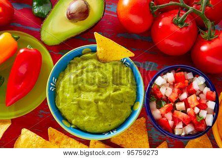 Mexican food nachos guacamole pico de gallo and chili peppers sauces